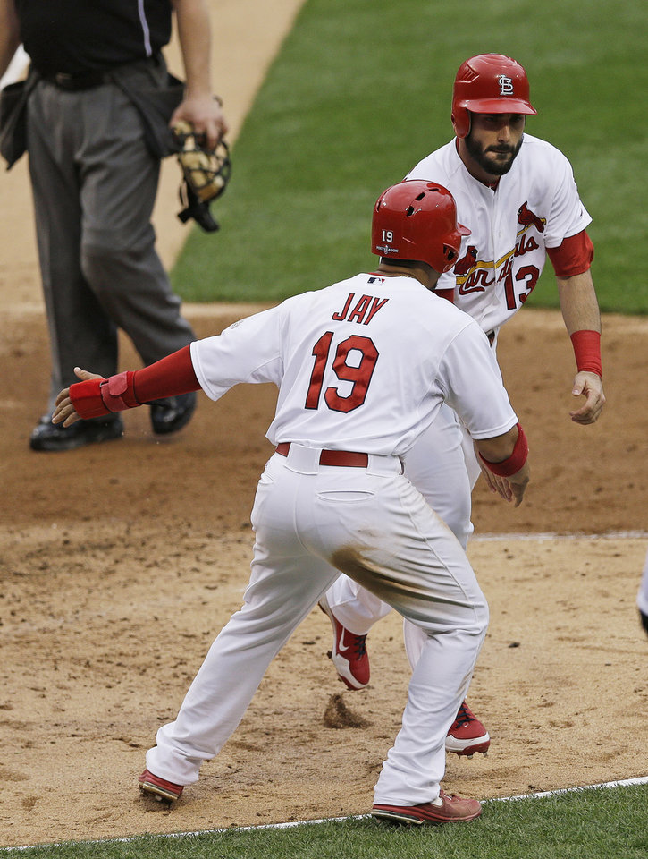 Photo -   St. Louis Cardinals' Matt Carpenter (13) celebrates his two-run home run with Jon Jay (19) during the third inning of Game 3 of baseball's National League championship series against the San Francisco Giants, Wednesday, Oct. 17, 2012, in St. Louis. (AP Photo/Patrick Semansky)