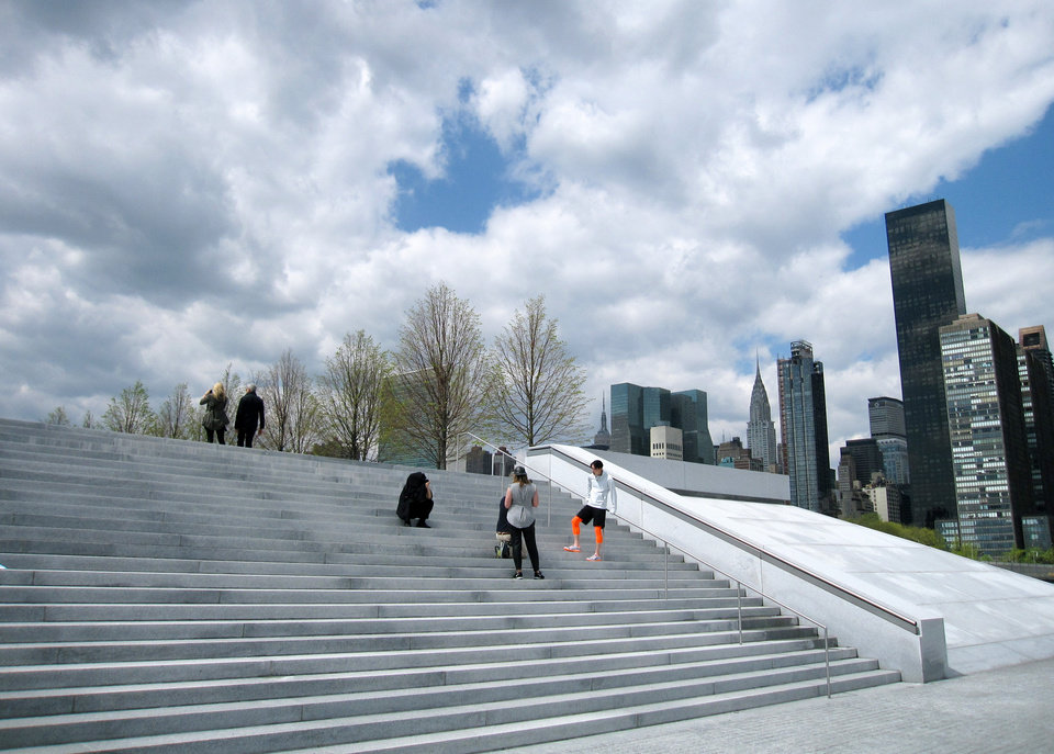Photo - This May 1, 2014 photo shows visitors on steps at Franklin D. Roosevelt Four Freedoms Park, located on Roosevelt Island in New York City. The park, designed by renowned architect Louis I. Kahn, is considered an architectural masterpiece and offers scenic views of the city. (AP Photo/Beth J. Harpaz)