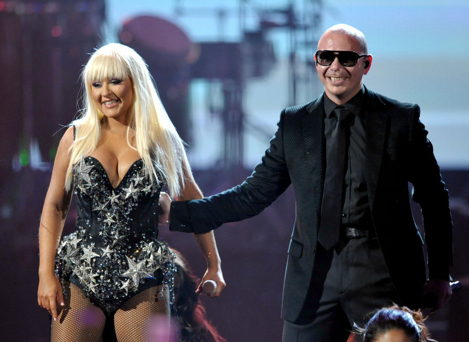 Photo -   Christina Aguilera, left, and Pitbull perform at the 40th Anniversary American Music Awards on Sunday, Nov. 18, 2012, in Los Angeles. (Photo by John Shearer/Invision/AP)
