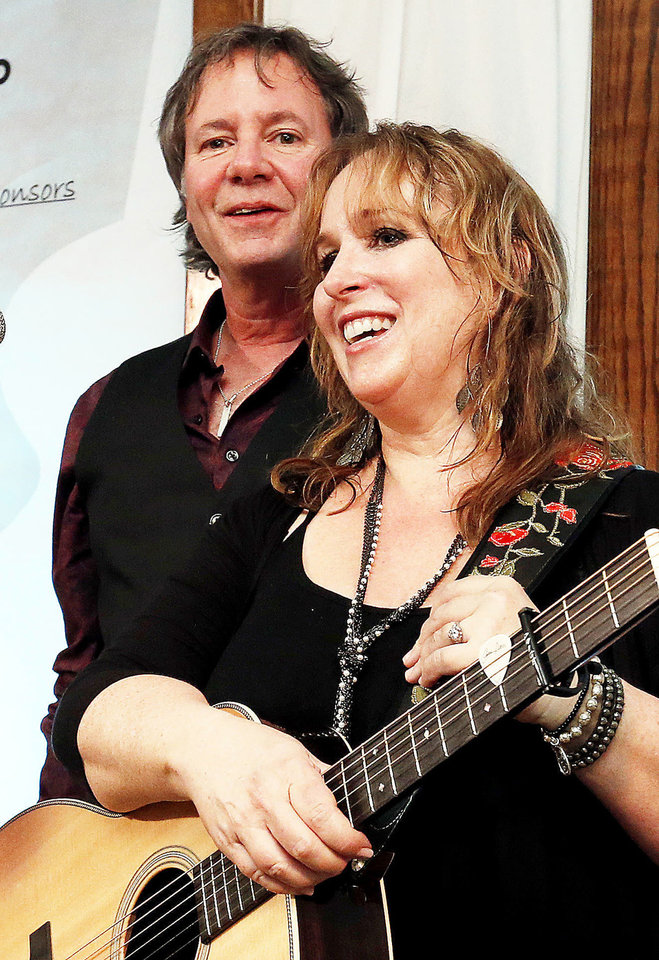Photo - Gretchen Peters and her accompaniest/husband Barry Walsh acknowledge the applause after their concert at the Performing Arts Studio at the Depot during a Winter Wind concert on Sunday, Jan. 27, 2013 in Norman, Okla.  Photo by Steve Sisney, The Oklahoman