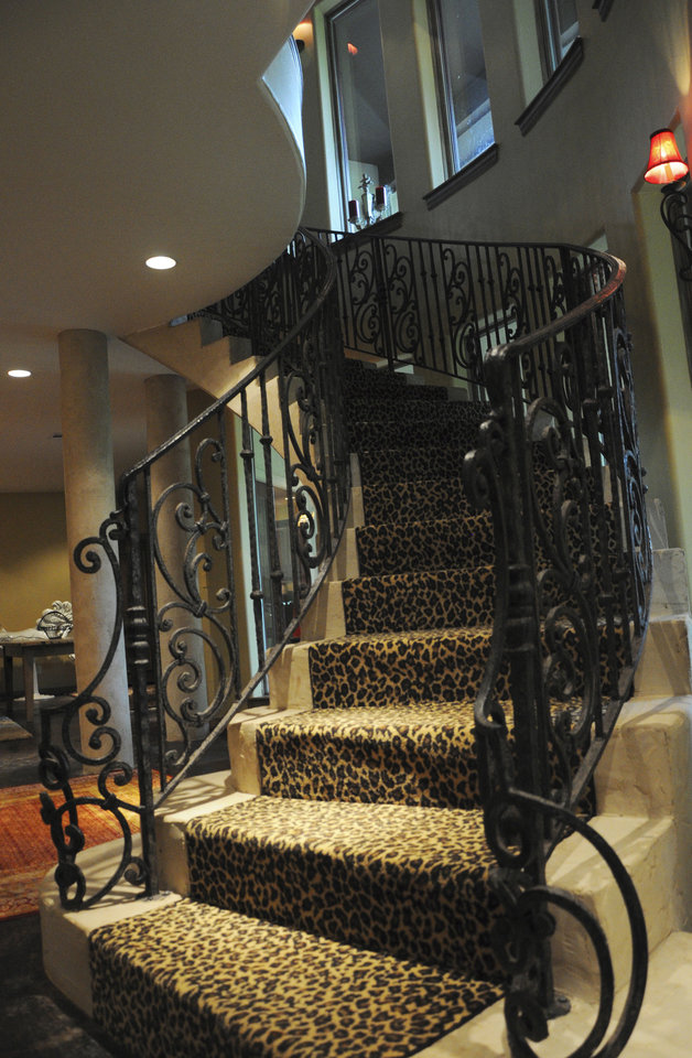 Photo - A full concrete staircase leads from the basement to the upper level of the house of builder Mike Hancock of Basement Contractors Inc. at 816 Honey Creek in Edmond.  KT King - The Oklahoman