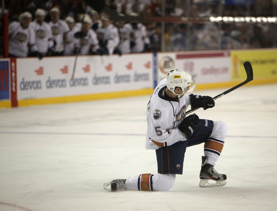 Photo - Oklahoma City's Justin Schultz (5) celebrates after scoring a goal during a game between the Oklahoma City Barons and the San Antonio Rampage at the Cox Convention Center in Oklahoma City, Friday, Oct. 19, 2012.  Photo by Garett Fisbeck, The Oklahoman