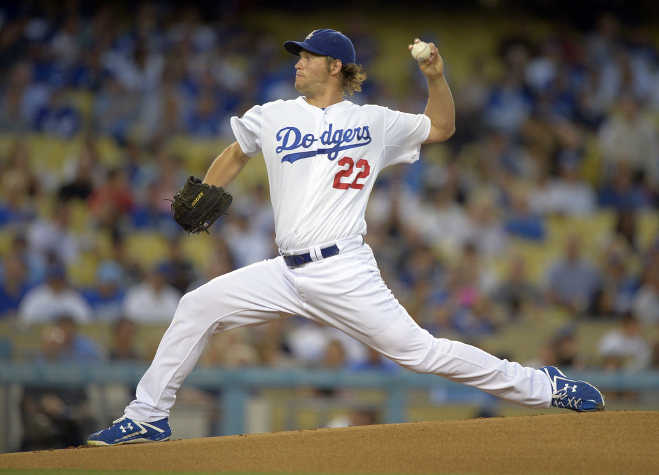 Photo -   Los Angeles Dodgers starting pitcher Clayton Kershaw throws to the plate during the first inning of their baseball game against the San Diego Padres, Tuesday, Sept. 4, 2012, in Los Angeles. (AP Photo/Mark J. Terrill)