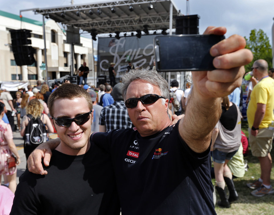"Photo - Nick Hart and son Curtis, Chickasha make a ""Selfie"" in front of the band Mama Sweet during the Norman Music Festival on Saturday, April 26, 2014 in Norman, Okla.  Photo by Steve Sisney, The Oklahoman"