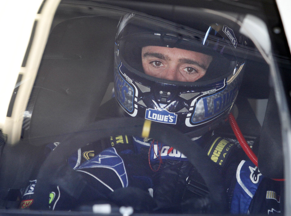 Photo - Driver Jimmie Johnson prepares to go out to practice for the NASCAR Sprint cup series Quaker State 400 at the Kentucky Speedway in Sparta, Ky., Friday, June28, 2013. (AP Photo/James Crisp)