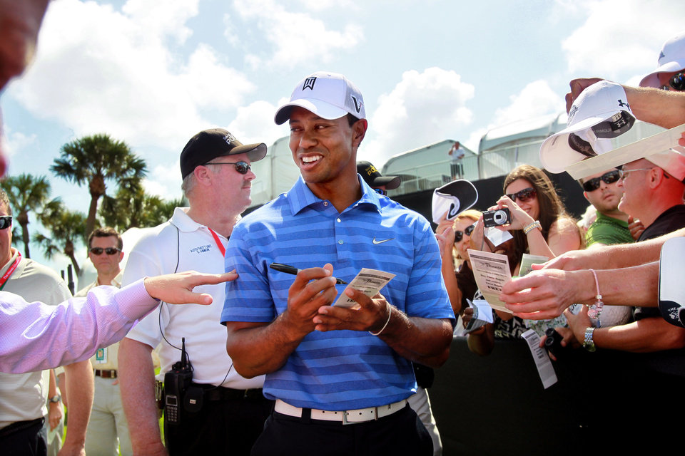 Tiger Woods signs autographs during a practice round for the Honda Classic golf tournament in Palm Beach Gardens, Fla., Tuesday, Feb. 28, 2012. (AP Photo/Palm Beach Post, Allen Eyestone) MAGS OUT TV OUT NO SALES