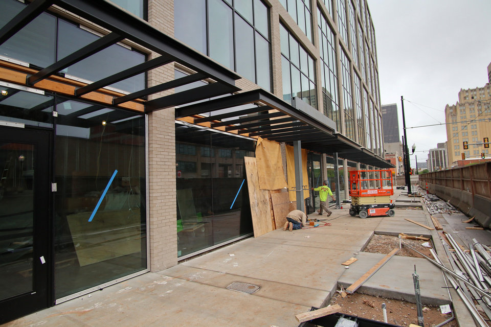 Photo - Main entrance on Broadway. Heartland building progress in downtown at 5th and Broadway, Wednesday, May 13, 2020. [Doug Hoke/The Oklahoman]