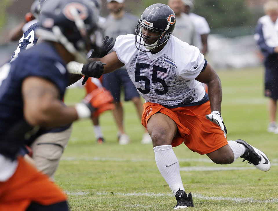 Photo - Chicago Bears linebacker Lance Briggs (55) works with teammates during NFL football training camp Friday, July 26, 2013, at Olivet Nazarene University in Bourbonnais, Ill. (AP Photo/Nam Y. Huh)