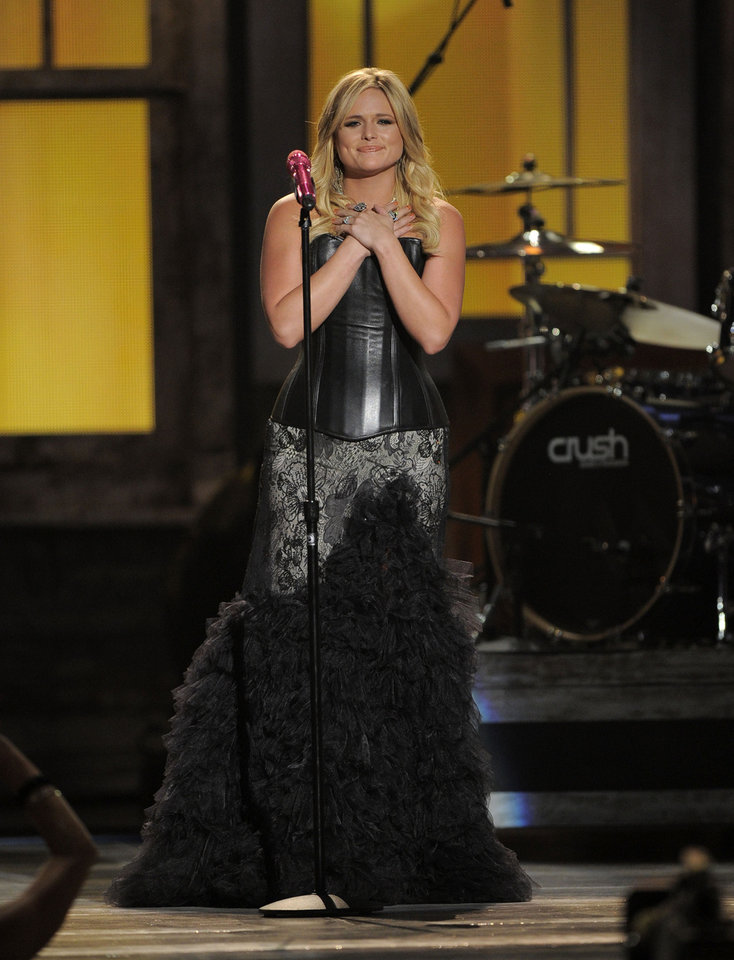 Photo - FILE - In this April 1, 2014 file photo, Miranda Lambert performs at the 47th Annual Academy of Country Music Awards in Las Vegas. The 2014 Academy of Country Music Awards in Las Vegas will air live Sunday night, April 6, 2014, from 8-11 p.m. EDT on CBS. Several awards, including top honor entertainer of the year, will be announced during the broadcast, to be hosted by Blake Shelton and Luke Bryan. Shelton, Bryan, George Strait, Miranda Lambert, Jason Aldean, Keith Urban, Tim McGraw, Shakira and Stevie Nicks are scheduled to perform.(AP Photo/Mark J. Terrill, File)