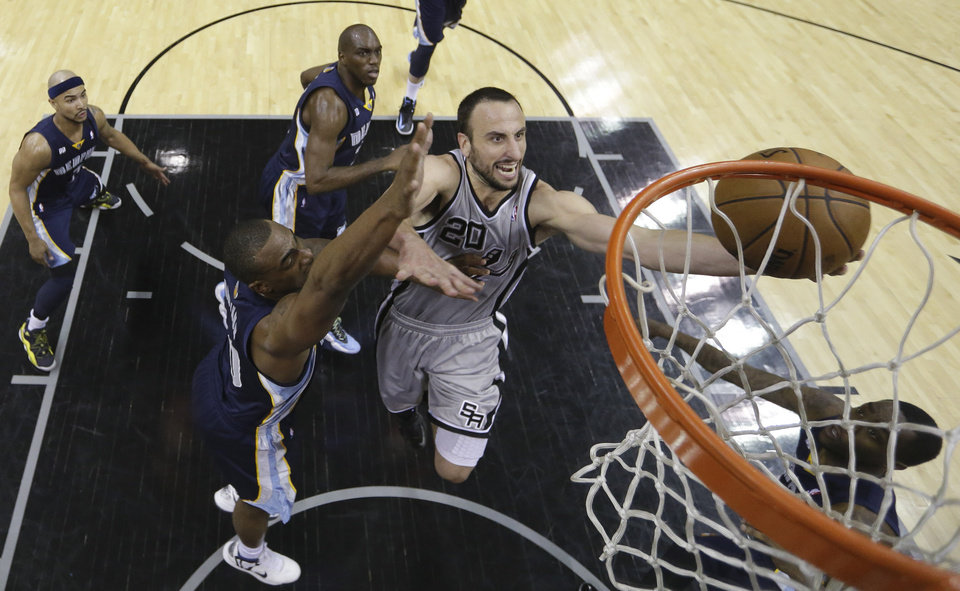 Photo - San Antonio Spurs' Manu Ginobili (20), of Argentina, drives to the basket as Memphis Grizzlies' Darrell Arthur, left, defends him during the second half in Game 1 of a Western Conference Finals NBA basketball playoff series, Sunday, May 19, 2013, in San Antonio. San Antonio won 105-83.(AP Photo/Eric Gay)