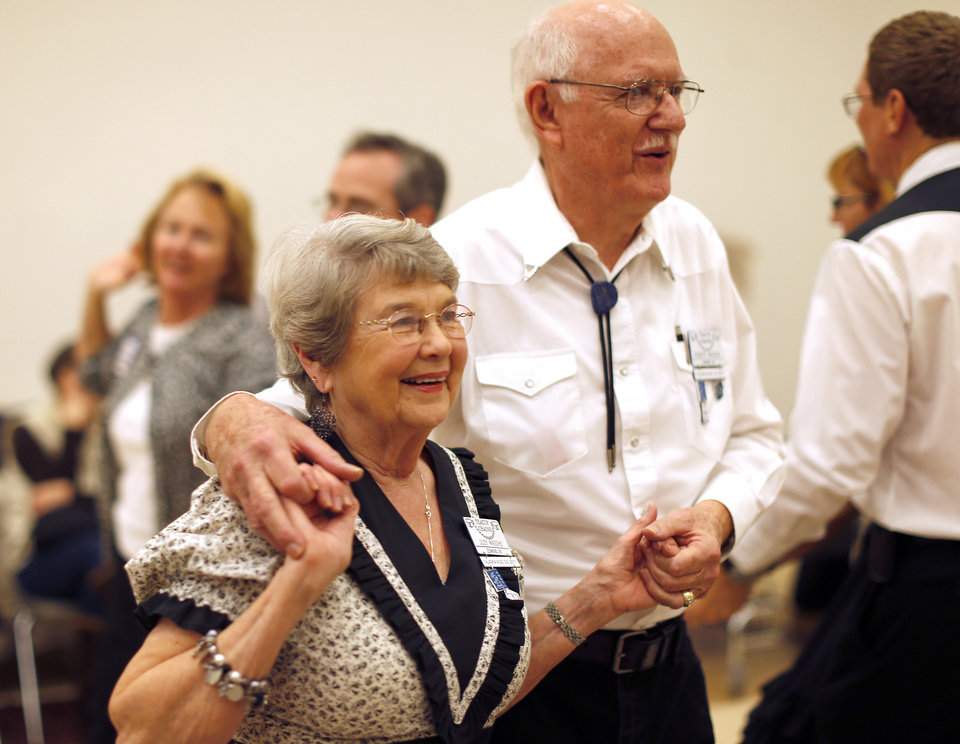 Photo - Judy and Robert Mascho dance during a Teacup Chains square dance at Peace Lutheran Church, in Edmond.  Photo by Sarah Phipps, The Oklahoman  SARAH PHIPPS - SARAH PHIPPS