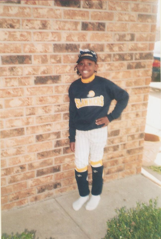 Photo - Courtney Walker poses in her softball uniform. PHOTO PROVIDED