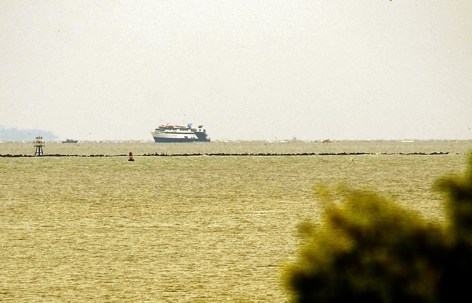 Photo - The casino boat Escapade, with 123 people aboard, is grounded off the coast of Tybee Island, Ga., Wednesday, July 16, 2014. No injuries or medical issues had been reported among the 96 passengers and 27 crew members aboard the boat according to Coast Guard Petty Officer 3rd Class Anthony L. Soto.  (AP Photo/Stephen B. Morton)