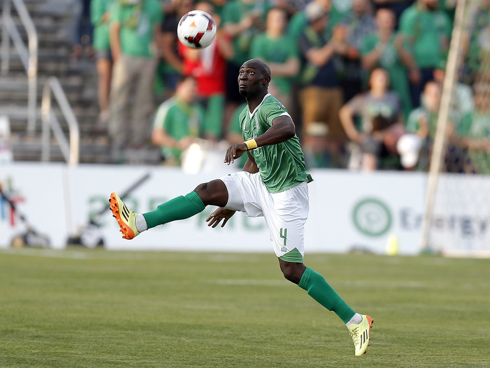 Photo - Oklahoma City's Cyprian Hedrick tracks down a loose ball during the OKC Energy FC soccer game against Orlando City SC at Pribil Stadium in Oklahoma City, Saturday, April 26, 2014. Photo by Sarah Phipps, The Oklahoman
