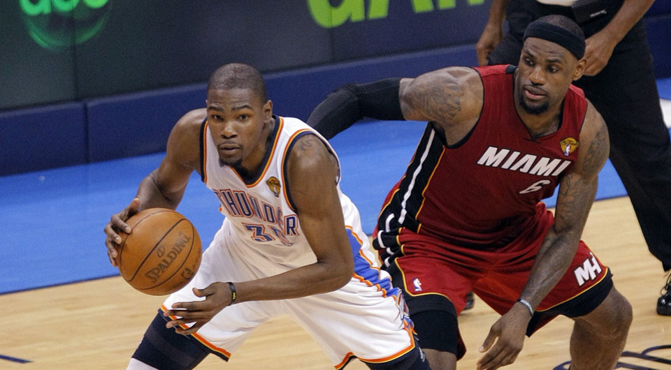 NBA BASKETBALL: Oklahoma City\'s Kevin Durant (35) drives past Miami\'s LeBron James (6) during Game 1 of the NBA Finals between the Oklahoma City Thunder and the Miami Heat at Chesapeake Energy Arena in Oklahoma City, Tuesday, June 12, 2012. Photo by Sarah Phipps, The Oklahoman