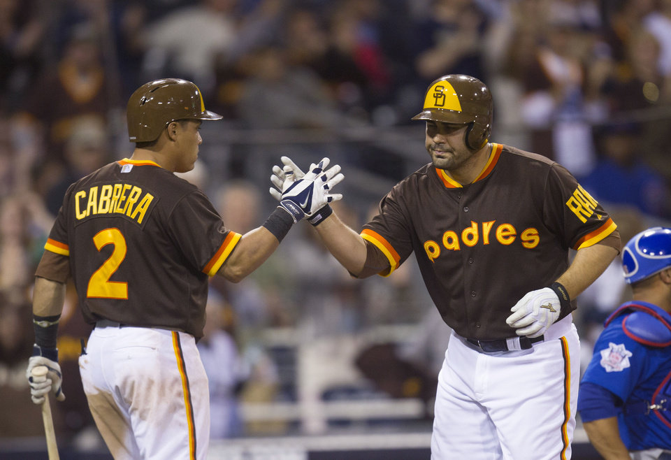 Photo - San Diego Padres' Carlos Quentin, right, is congratulated at the plate by Everth Cabrera after hitting a two-run home run in the eighth inning of a baseball game against the Chicago Cubs, Saturday, May 24, 2014, in San Diego. (AP Photo/Sean M. Haffey)