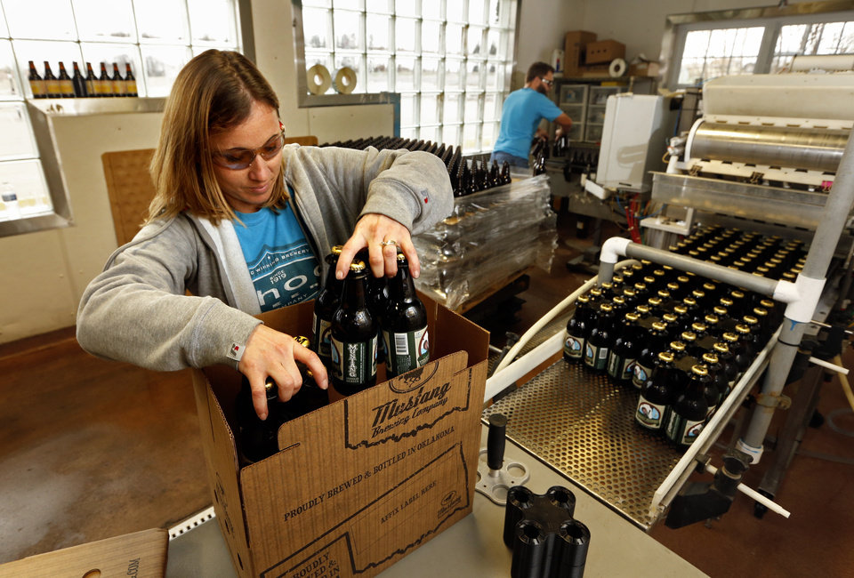 Photo -  Billie Vazquez packs Choc Beer at Krebs Brewing Co. [Photo by Steve Sisney, The Oklahoman Archives]