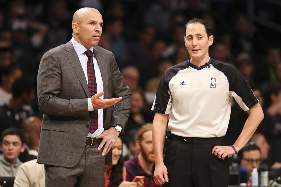 Photo - Brooklyn Nets head coach Jason Kidd, left, argues with referee Marat Kogut in the second half of an NBA basketball game against the Los Angeles Lakers at the Barclays Center, Wednesday, Nov. 27, 2013, in New York. The Lakers defeated the Nets 99-94. (AP Photo/John Minchillo)