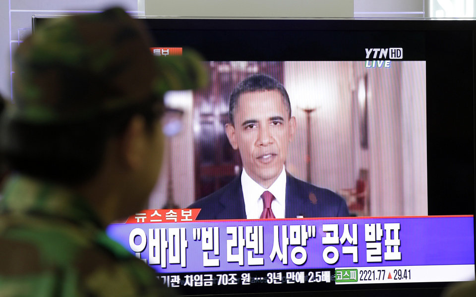 Photo - A South Korean soldier watches a live TV broadcast of U.S. President Barack Obama speaking about Osama bin Laden at Seoul train station in Seoul, South Korea, Monday, May 2, 2011. Osama bin Laden, the glowering mastermind behind the Sept. 11, 2001, terror attacks that killed thousands of Americans, was killed in an operation led by the United States, President Barack Obama said Sunday. The Korean caption reads:
