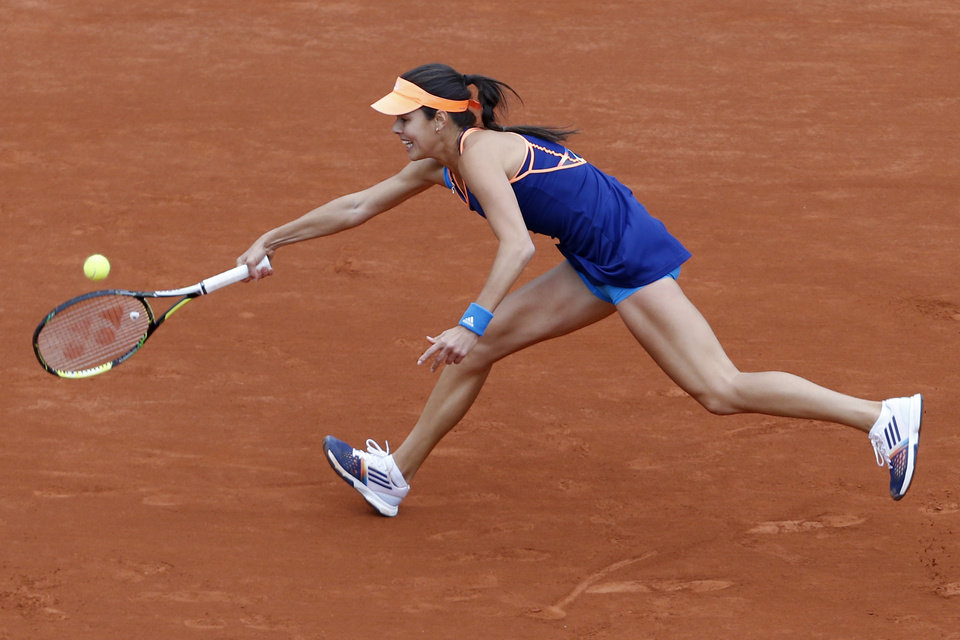 Photo - Serbia's Anna Ivanovic returns the ball during the second round match of the French Open tennis tournament against Ukraine's Elina Svitolina at the Roland Garros stadium, in Paris, France, Thursday, May 29, 2014. (AP Photo/Darko Vojinovic)