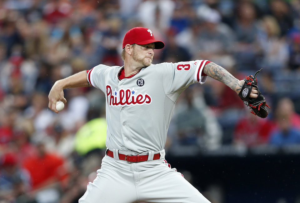 Photo - Philadelphia Phillies starting pitcher A.J. Burnett works in the first inning of a baseball game against the Atlanta Braves in Atlanta, Friday, July 18, 2014. (AP Photo/John Bazemore)