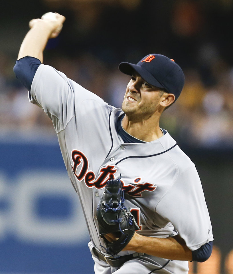 Photo - Detroit Tigers starting pitcher Rick Porcello works against the San Diego Padres during the first inning of a baseball game Friday, April 11, 2014, in San Diego. (AP Photo/Lenny Ignelzi)