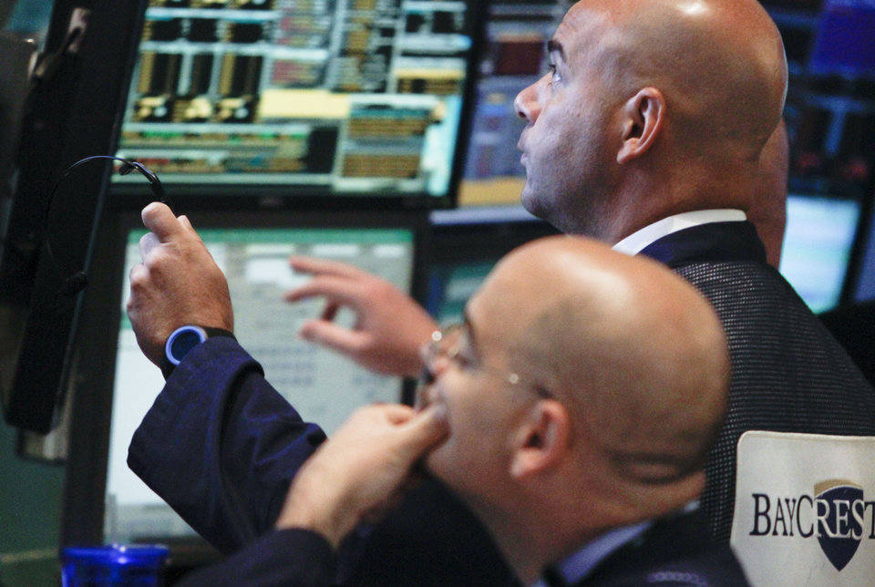Photo -   FILE- In a Tuesday, July 10, 2012, file photo, traders work at the start of early trading at the New York Stock Exchange. U.S. stocks slid for a sixth day Thursday, July 12, 2012, as concern spread that weaker global economic growth and the European debt crisis will hurt U.S. corporate earnings. (AP Photo/Bebeto Matthews, File)