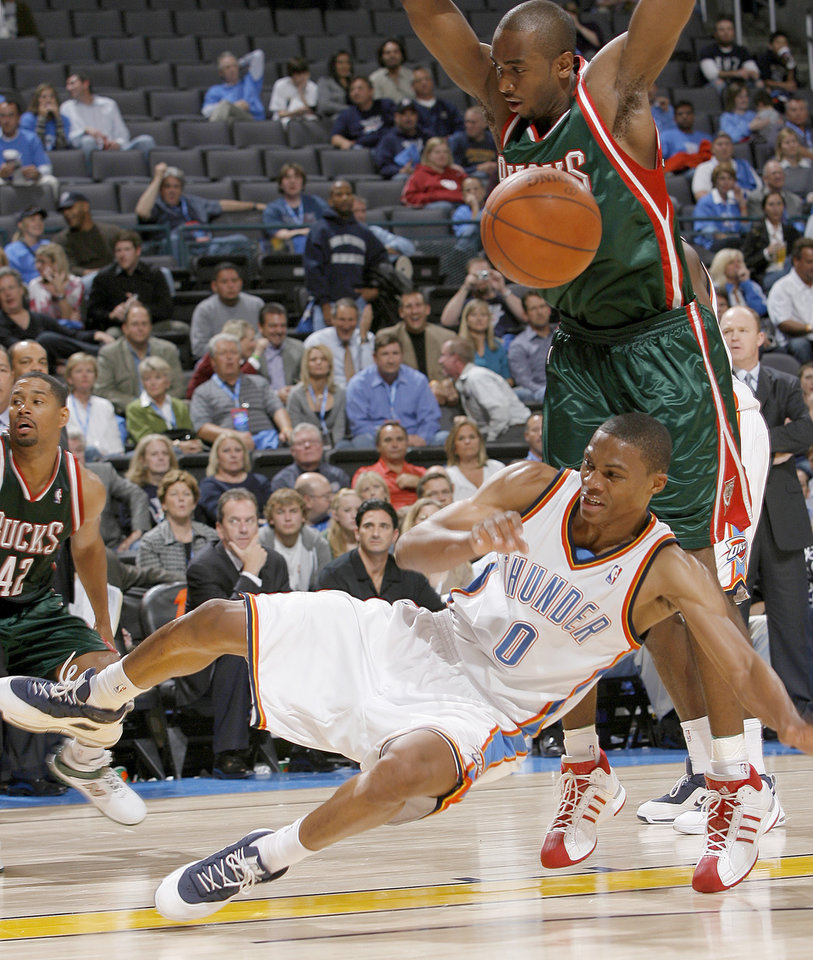Russell Westbrook of Oklahoma City falls under Luc Richard Mbah a Moute of Milwaukee during the opening NBA basketball game between the Oklahoma City Thunder and the Milwaukee Bucks at the Ford Center in Oklahoma City, Wednesday, October 29, 2008.  BY BRYAN TERRY, THE OKLAHOMAN