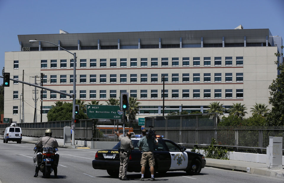 Los Angeles Sheriff block the access to the Cal State University Los Angeles after a mandatory evacuation on a report of a suspicious item, according to the Los Angeles Police Department in Los Angeles Thursday, April 18, 2013. Two telephoned bomb threats prompted officials at Cal State Los Angeles today to cancel afternoon classes and evacuate the campus. (AP Photo/Damian Dovarganes)