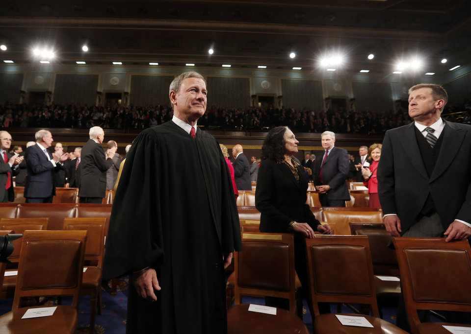 Photo - Supreme Court Chief Justice John Roberts arrives for President Barack Obama's State of Union address before a joint session of Congress in the House chamber Tuesday, Jan. 28, 2014. (AP Photo/Larry Downing, Pool)