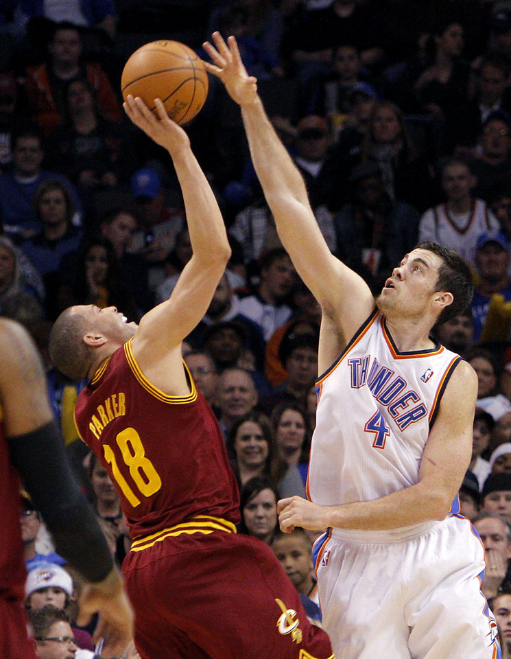 Photo - Oklahoma City's Nick Collison pressures and fouls Cleveland's Anthony Parker  during the first half of their NBA basketball game at the OKC Arena in Oklahoma City on Sunday, Dec. 12, 2010.  The Thunder beat the Cavaliers106-77. Photo by John Clanton, The Oklahoman