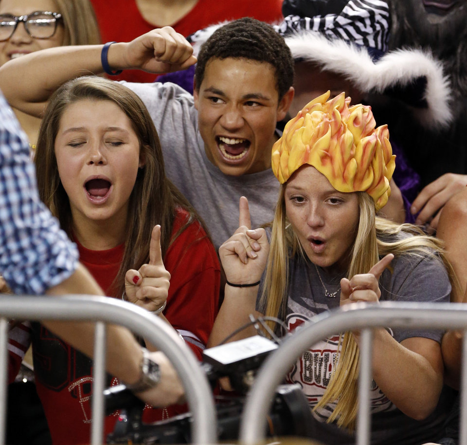 Adair fans ham it up for a videographer during the 3A girls semifinal game between the Adair High School Lady Warriors and the Sulphur Lady Bulldogs at the State Fair Arena on Friday, March 8, 2013 in Oklahoma City, Okla.  Photo by Steve Sisney, The Oklahoman