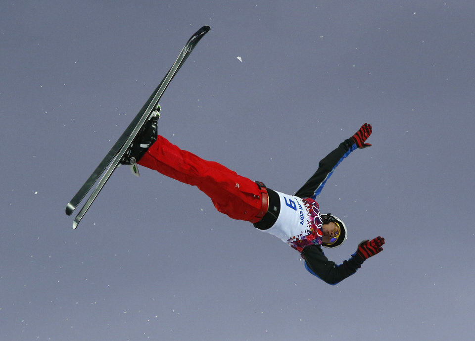 Photo - China's Jia Zongyang jumps during men's freestyle skiing aerials qualifying at the Rosa Khutor Extreme Park, at the 2014 Winter Olympics, Monday, Feb. 17, 2014, in Krasnaya Polyana, Russia.(AP Photo/Sergei Grits)