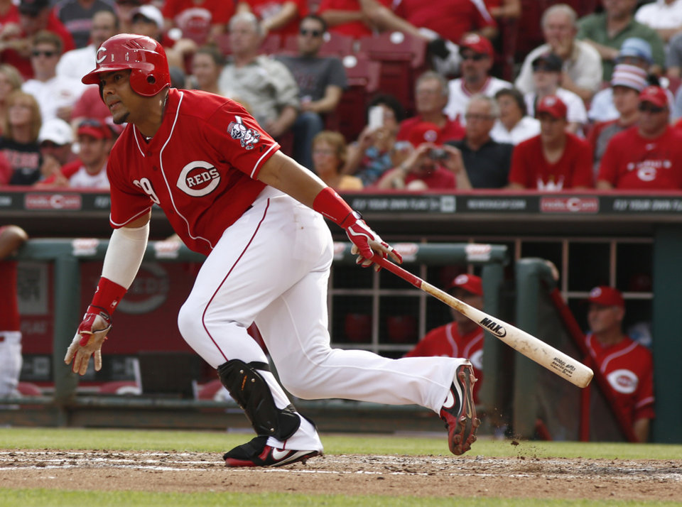 Photo - Cincinnati Reds' Brayan Pena watches his RBI-single hit off Washington Nationals starting pitcher Gio Gonzalez in the fifth inning of a baseball game on Saturday, July 26, 2014, in Cincinnati. (AP Photo/David Kohl)