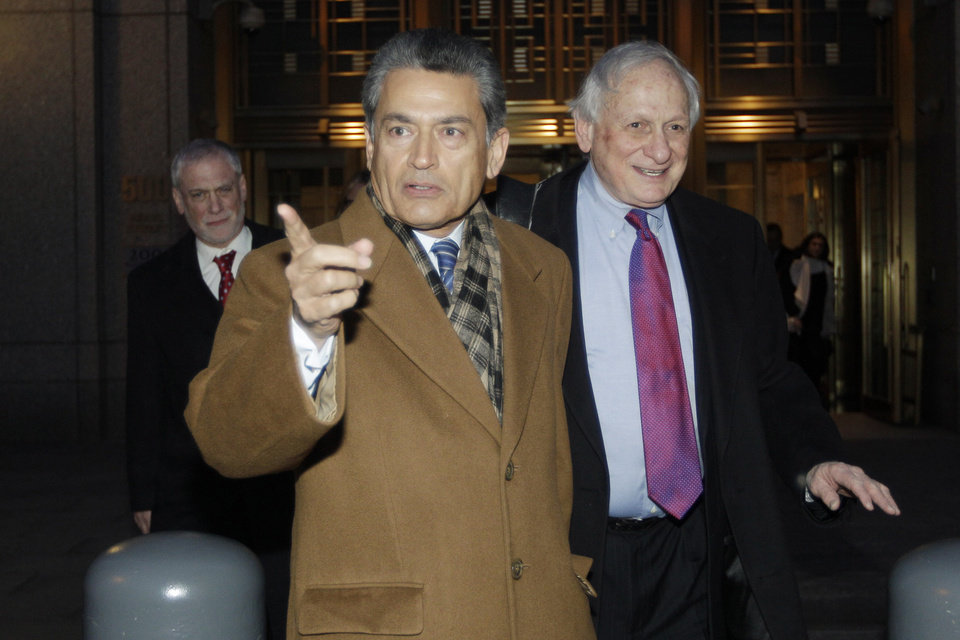Photo -   FILE- In this Jan. 5, 2012 file photo, former Goldman Sachs board member Rajat Gupta, left, exits Manhattan federal court with his attorney Gary Naftalis, in New York. The insider trading trial of the former board member for Goldman Sachs and Procter & Gamble begins in New York on Monday, May 21, 2012, with jury selection. (AP Photo/Mary Altaffer, File)