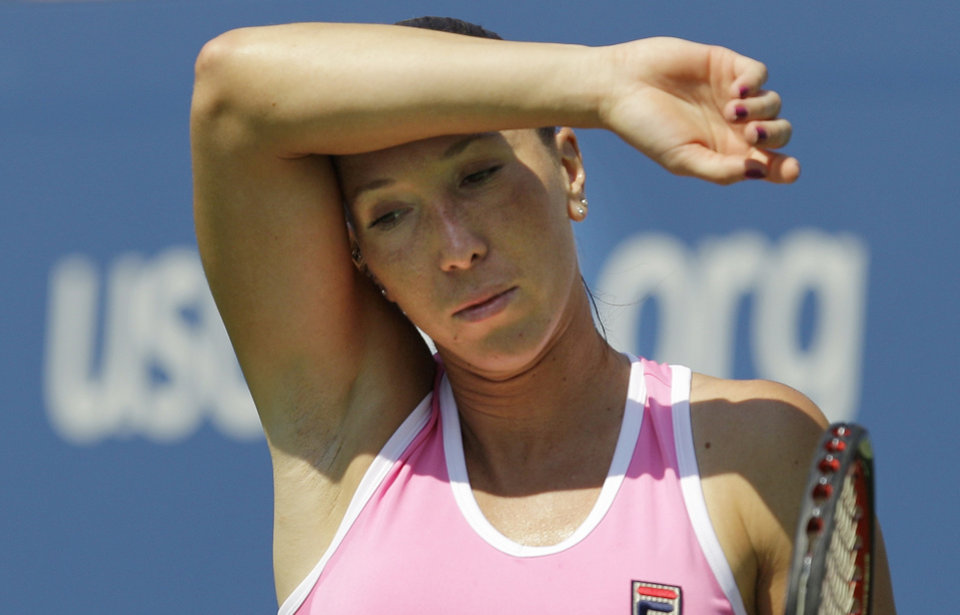 Photo -   Serbia's Jelena Jankovic returns a shot to Agnieszka Radwanska, of Poland, in the third round of play at the 2012 US Open tennis tournament, Saturday, Sept. 1, 2012, in New York. (AP Photo/Kathy Willens)