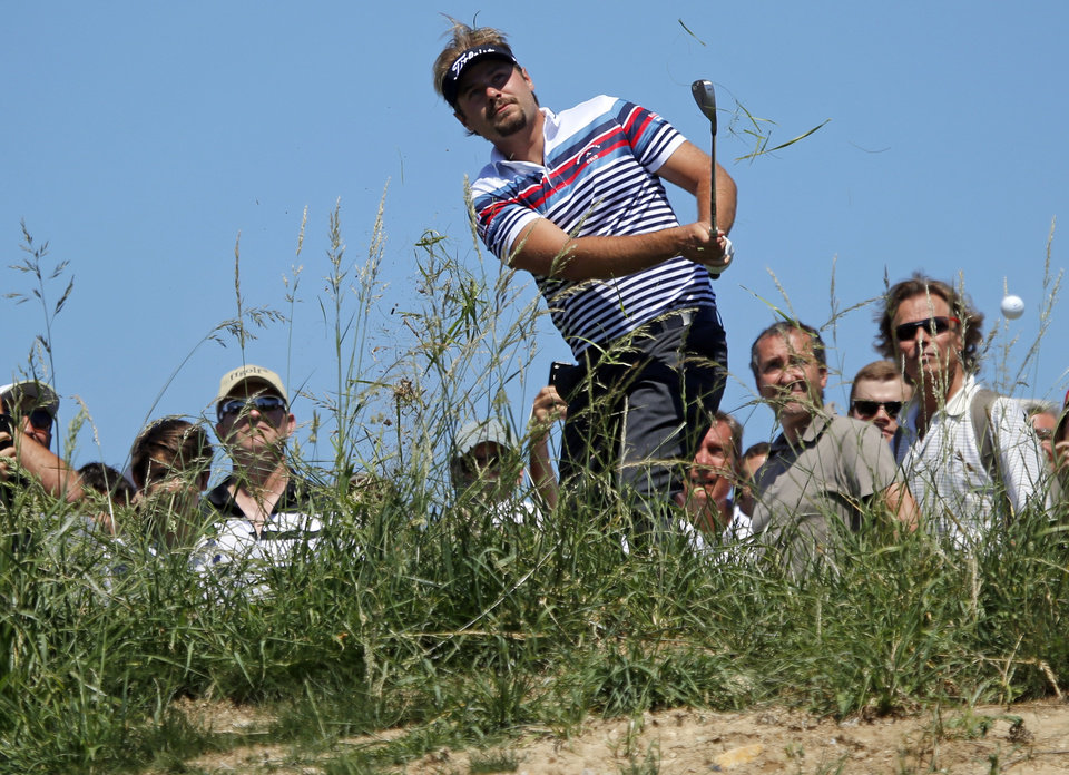 Photo - Victor Dubuisson of France tees off during the first day of the French Open Golf tournament at Paris National course in Guyancourt, west of Paris, France, Thursday, July 3, 2014. (AP Photo/Francois Mori)
