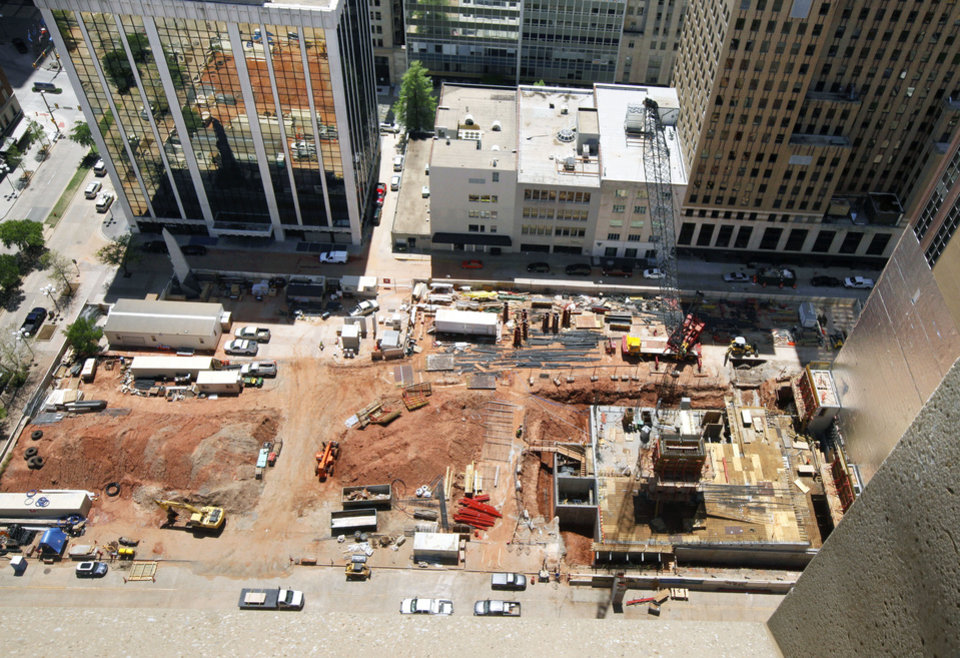 Photo - Construction is proceeding on the Sandridge Energy grounds in downtown Oklahoma City. SandRidge announced Monday the building being built at 120 Robert S. Kerr Ave. shown in this photo, will be redesigned from employee amenities to leasable office space.  PAUL HELLSTERN - Oklahoman