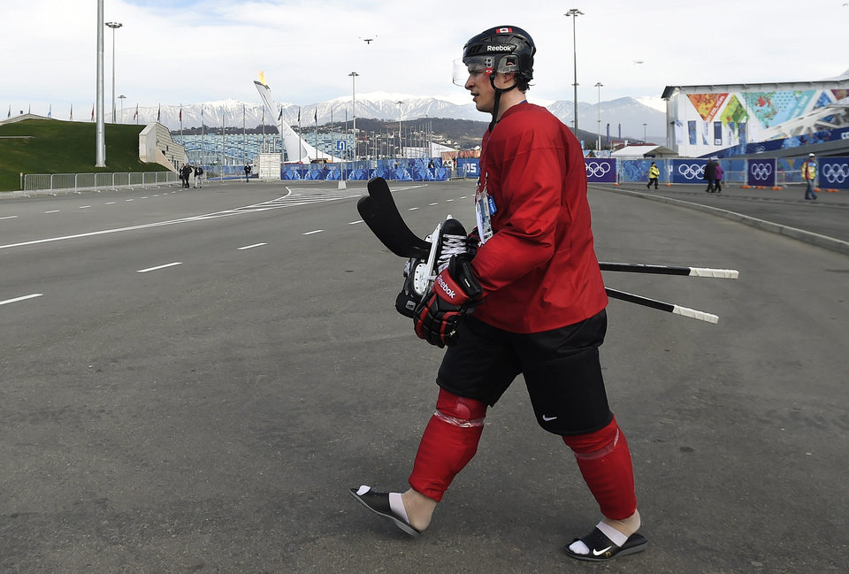 Photo - Canada's men's captain Sidney Crosby walks from hockey practice to the team's dressing room during the 2014 Sochi Winter Olympics in Sochi, Russia on Wednesday, Feb. 12, 2014. (AP Photo/The Canadian Press, Nathan Denette)