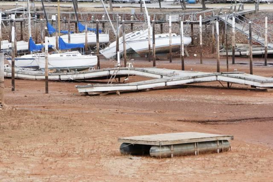 Boats at the Oklahoma City Yacht Club sit on dry land Tuesday at Lake Hefner in Oklahoma City. The lake has hit its lowest water level in its 66-year history. PHOTO BY PAUL HELLSTERN, THE OKLAHOMAN