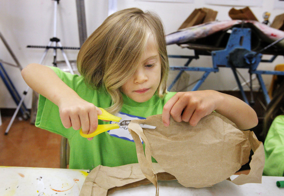 Avery Head, 4, makes a stuffed paper fish during an arts summer camp at the Edmond Fine Arts Institute.