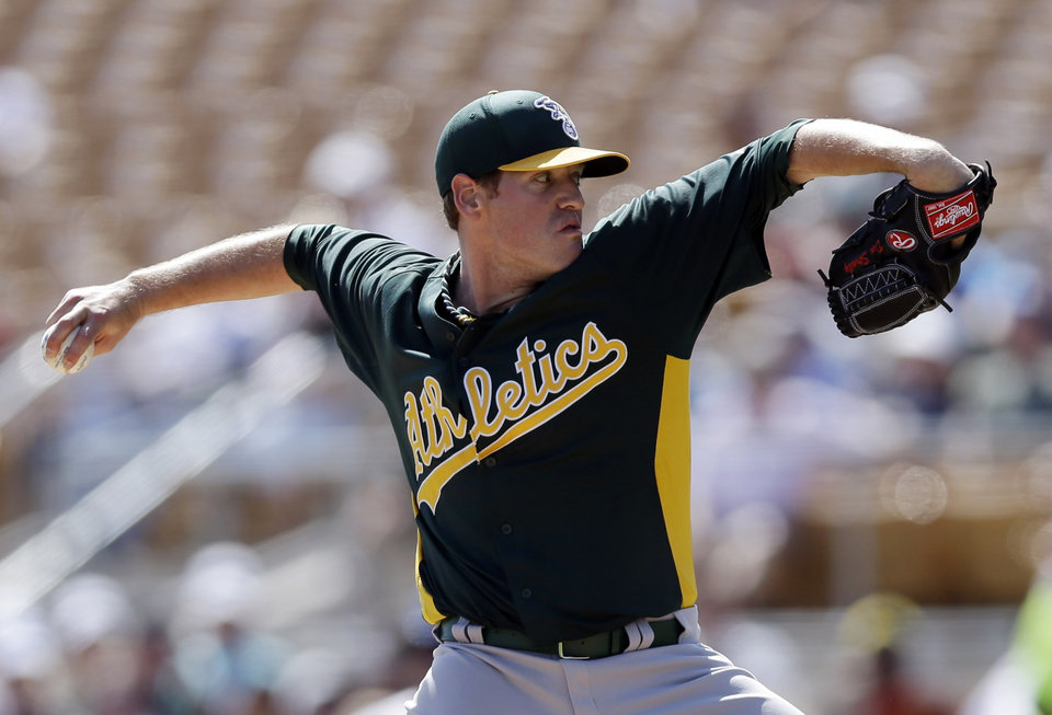 Photo - Oakland Athletics starting pitcher Dan Straily throws to the Los Angeles Dodgers during the third inning of a spring training baseball game on Tuesday, March 19, 2013 in Glendale, Ariz. (AP Photo/Marcio Jose Sanchez)