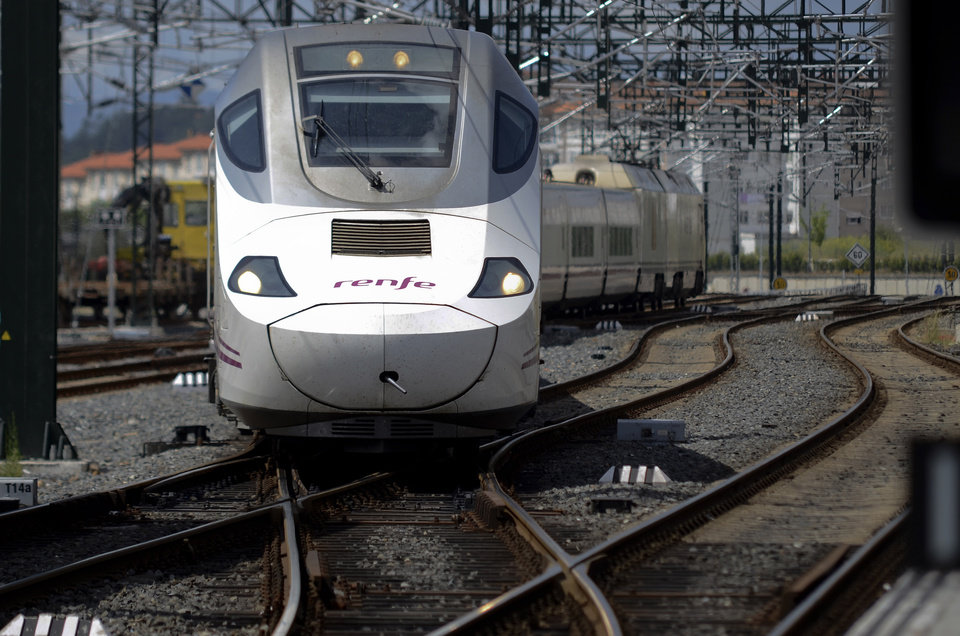 "Photo - A passenger 'Alvia' type train pulls into the station in Santiago de Compostela, Spain, Friday July 26, 2013. The 'Alvia' train, the same as the one that crashed Wednesday is the first to operate on this line after the accident. Investigators have taken possession of the ""black boxes"" of the Spain train that hurtled at high-speed along a curve and derailed, killing 80 people, a court official said Friday. Analysis will be performed to determine why the train was traveling far above the speed limit when it crashed near a station in Santiago de Compostela, in the northwestern Galicia region, said court spokeswoman Maria Pardo Rios. The train's operator remained hospitalised Friday and will be questioned by police but she said the interview will not happen Friday. (AP Photo/Brais Lorenzo)"
