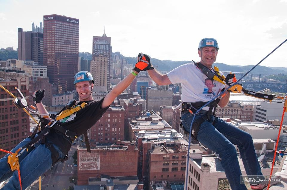 Photo -  Andrew Carlson, left, and Gary Mendell, founder of Shatterproof, rappel at a Shatterproof Challenge in Pittsburgh. Photo provided       -