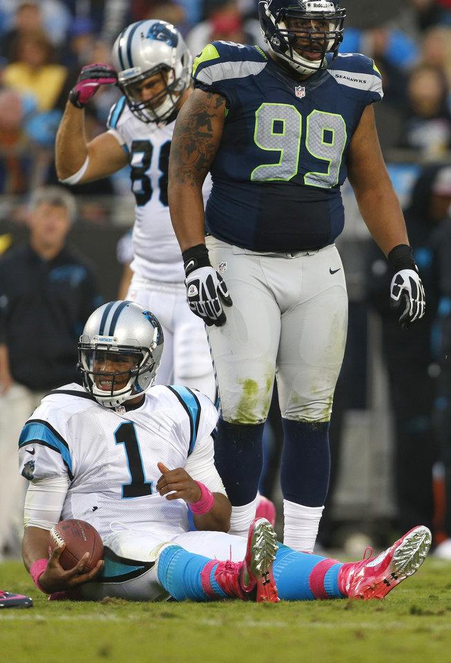 Carolina Panthers' Cam Newton (1) reacts after being sacked by Seattle Seahawks' Alan Branch (99) during the third quarter of an NFL football game in Charlotte, N.C., Sunday, Oct. 7, 2012. (AP Photo/Bob Leverone)