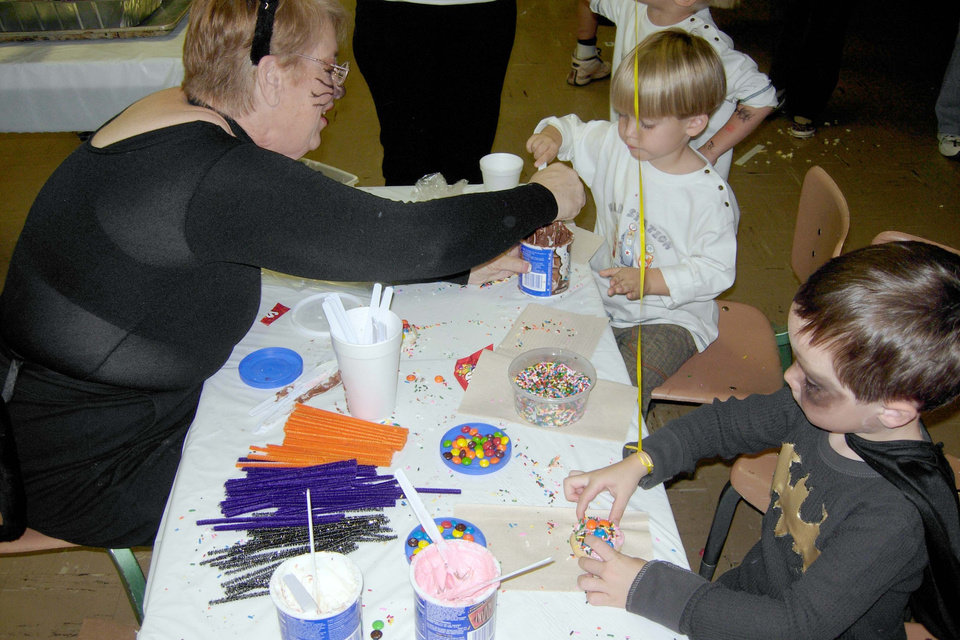Diana Cassady helps John Machtolff and Cole Lyles decorate cookies at the Arts and Crafts booth at the Family Fall Festival and Trunk or Treat event at First Christian Church in Guthrie on Sunday, Oct. 28.<br/><b>Community Photo By:</b> Karen Allen<br/><b>Submitted By:</b> Karen,