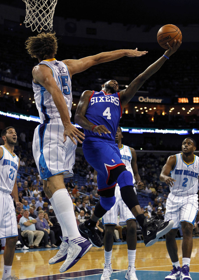 Philadelphia 76ers small forward Dorell Wright (4) drives to the basket against New Orleans Hornets center Robin Lopez (15) in the first half of an NBA basketball game in New Orleans, Wednesday, Nov. 7, 2012. (AP Photo/Gerald Herbert)