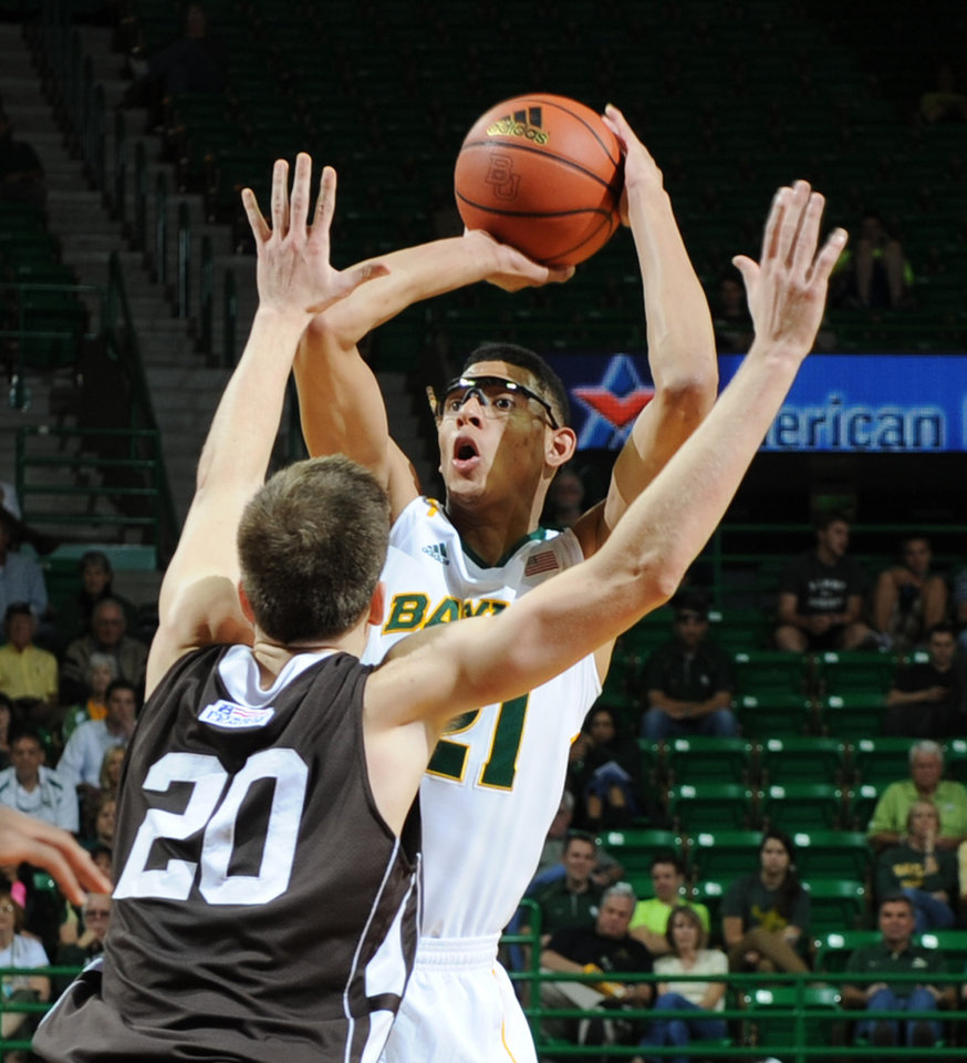 Photo -   Baylor's Isaiah Austin (21), right, shoots over Lehigh's Holden Greiner (20), left, in the first half of an NCAA college basketball game on Friday, Nov. 9, 2012, in Waco, Texas. (AP Photo/Waco Tribune Herald, Rod Aydelotte)