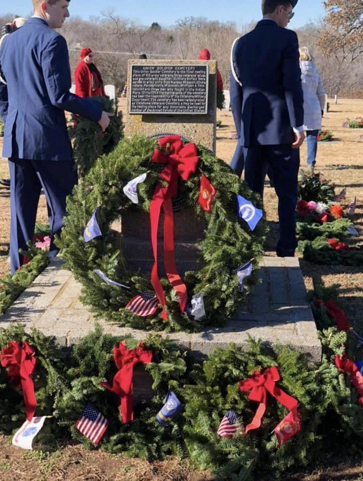 Photo - Memorial to fallen service members decorated with fresh balsam wreaths. PHOTO PROVIDED