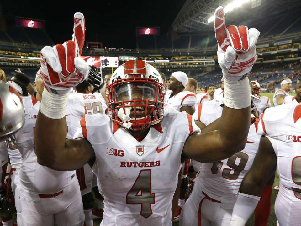 Photo - Rutgers wide receiver Leonte Carroo (4) celebrates after Rutgers beat Washington State 41-38 in an NCAA college football game, Thursday, Aug. 28, 2014, in Seattle. (AP Photo/Ted S. Warren)